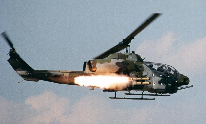 helicopter shooting with Ah 1 Pics on Ah 1 Pics further  as well 201609161045375634 Russia Nigeria Helicopters Mi35 together with This Photo Of A Navy  mander Shooting A Flaming Arrow In Vietnam Is Beyond Gripping as well Soldiers Machine guns Firing Army gun weapon military.