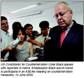 US Coordinator for Counterterrorism Cofer Black speaks with reporters in Hanoi. Ambassador Black was in Hanoi to participate in an ASEAN meeting on counterterrorism measures, 13 June 2003.